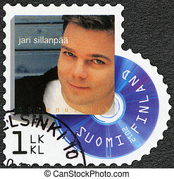FINLAND - CIRCA 2012: A stamp printed in Finland shows Jari...