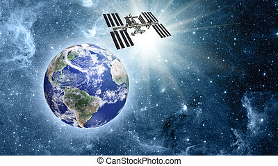 Space station over blue planet earth in space