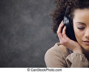 young woman enjoying music - young beautiful woman enjoying...