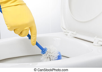 Cleaning Bathroom Lavatory with Blue Brush and Yellow Rubber...
