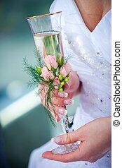 wedding glass in hands of bride