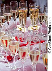 bride and groom glasses of champagne