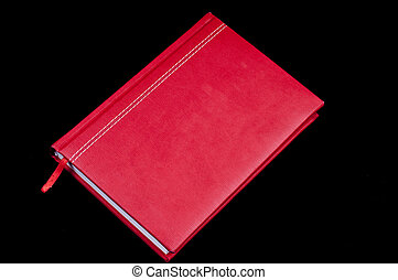 Red letter diary on the black background
