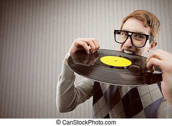 Nerd student angry, biting a vinyl record