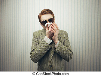blowing nose - Young man blowing her nose with kleenex, old...