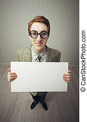 Business man nerd holds a blank sign, ready for your text,...