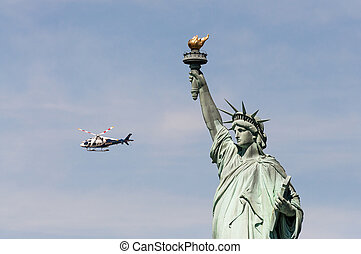 NYDP helicopter near Statue of Liberty, USA - NEW YORK -...