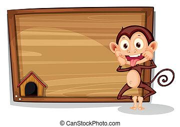 A monkey beside an empty board