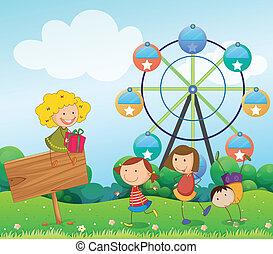 An empty signboard with kids near a ferris wheel -...
