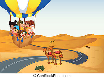The hot air balloon with kids at the desert