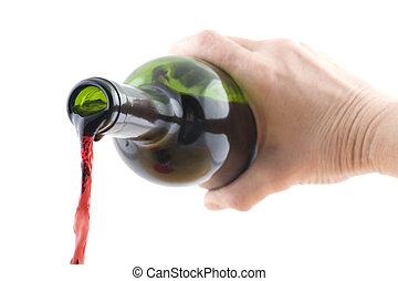 Open wine bottle in hand