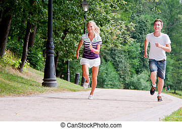 a man and a woman running in the pa