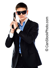 FBI agent - young and handsome man with a gun in his hand