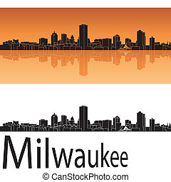 Milwaukee skyline in orange background in editable vector...