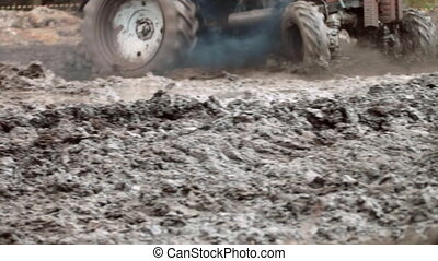 tractor rides on an impassable mud