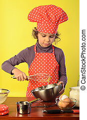 Little Chef - Little cook, girl of 8-9 years old, beating...