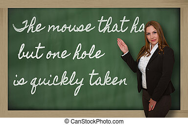 Successful, beautiful and confident woman showing The mouse...