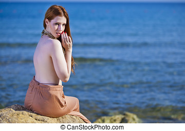 A beautiful woman with pale white skin and long red hair...