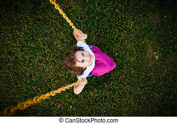 Girl on a swing - Cute little girl on a swing