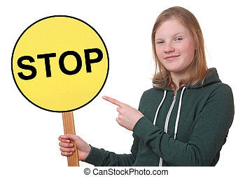 Teen holds sign