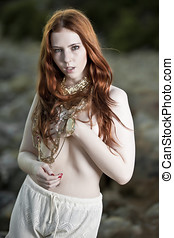 A semi-nude woman with beautiful white skin and long red...
