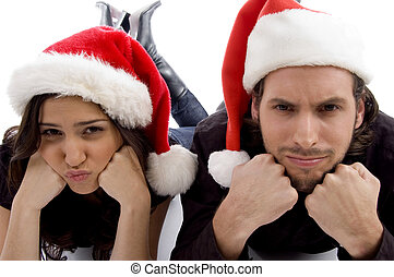 close up view of young couple wearing christmas hat and...