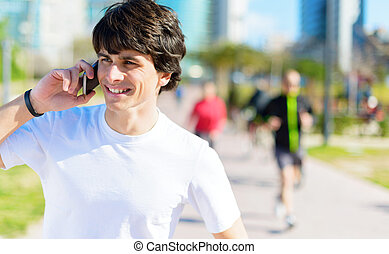 Young Man Talking On Cellphone - Happy Young Man Talking On...