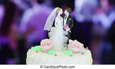 Figures on a wedding cake - Figures newlyweds on background...