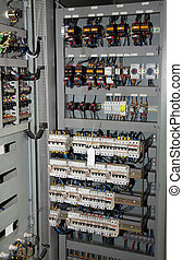 fuses and switches ammeters and measuring instruments in an industrial electrical panel