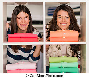 Two Female Friends Shopping - Two Happy Young Female Friends...