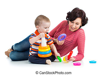 baby boy and mother playing together