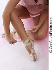 closeup on ballerina tying tip shoes - closeup on dancer's...