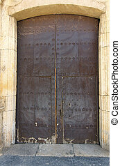 old metal door with rusted rivets