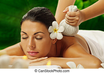 on massage - portrait of young beautiful woman in spa...