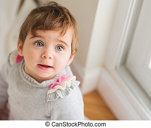 Cute Baby Looking Up, Indoors