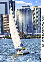 Sailboat in Toronto harbor - Sailboat sailing in Toronto...