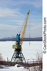 special crane boom. North Port in the winter. A bright sunny...