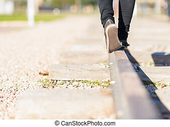 Girl Walking On The Railroad - Woman Walking In Equilibrium...