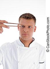 kok, Het kijken, eetstokjes