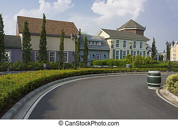 curve of road to beautiful houses