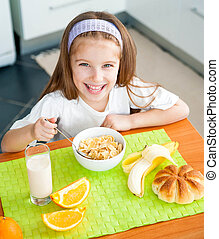little girl eating her breakfast - cute little girl eating...