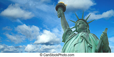 Statue of Liberty panorama with bright blue cloudy sky, New York