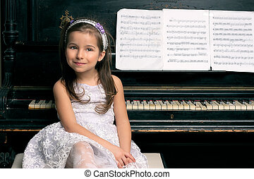Cute 5 year old girl sitting by piano - Cute five year old...