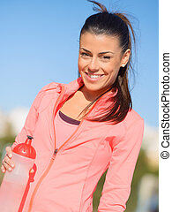 Sporty Woman Holding Bottle