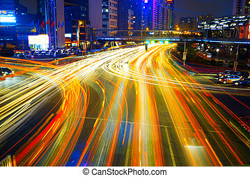 moving car with city - moving car with blur light through...