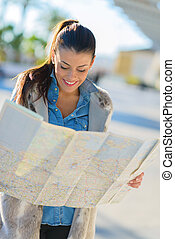 Beautiful Woman Looking In Map - Happy Beautiful Woman...