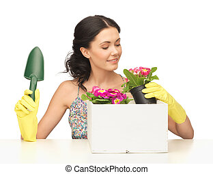 housewife with flower in pot and gardening set - lovely...