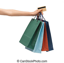 multi colored shopping bags and credit card - closeup of...