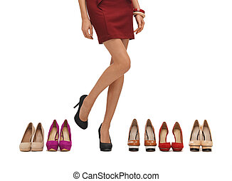 woman's long legs with high heels and shoes.