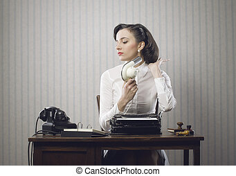 Business woman drying her hair in office